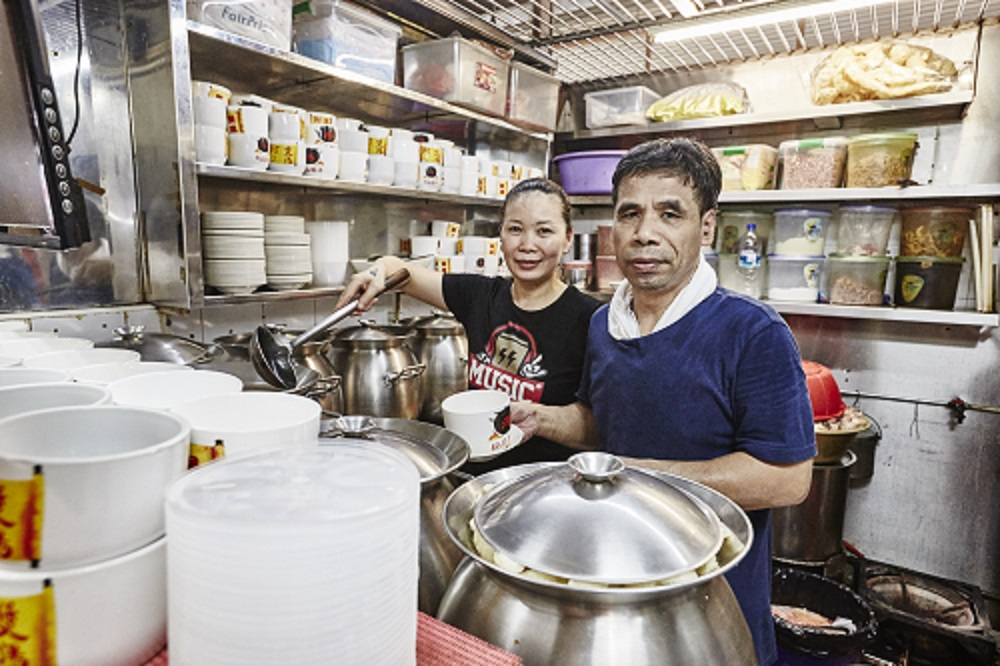 Husband and wife Chen Hua Qiang, 50, and Qu Fa Di, 46, serve up soups at ABC Brickworks Market
