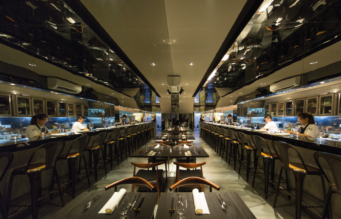 The mirrored wall in Meta helps increase the sense of space in the restaurant.