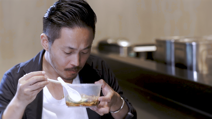 Chef Yuki gamely tries a take-away bowl of duck noodles from local stall Yu Kee (友记卤鸭之家).