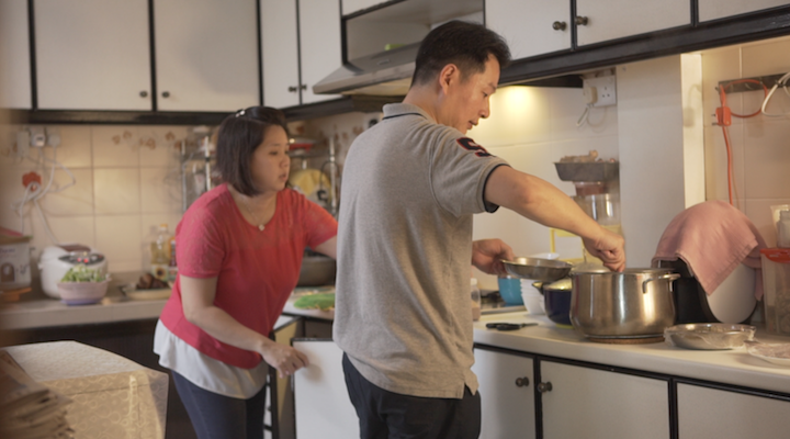Chef Liu and his wife prepare the food for their second round of reunion dinner on Chinese New Year's Eve.