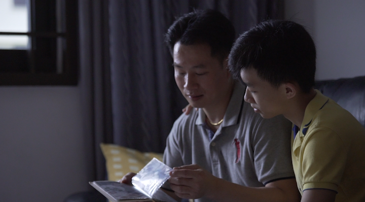 Chef Liu shares a tender moment with his younger son, Nicholas.