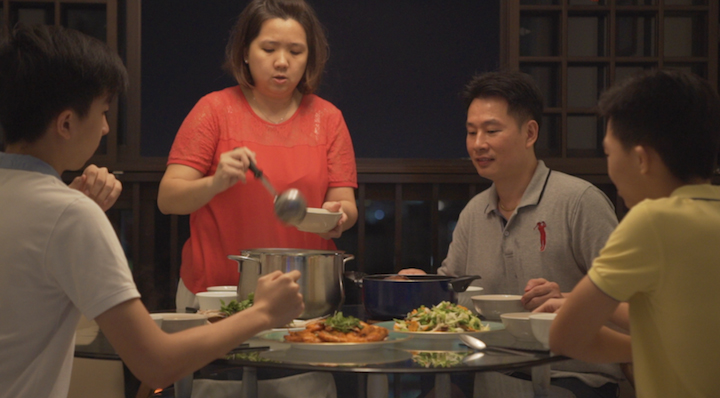 Chef Liu having a meal with his wife, Madam Yap Su Fern and two sons (from left), Clement, 18 and Nicholas, 17.