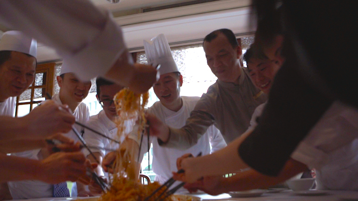Chef Liu Ching Hai (middle) and his staff make it a point to have a lo hei before they commence dinner service on Chinese New Year's Eve. Photo: Han Pin